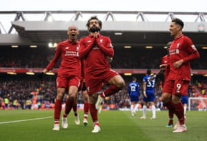 Mohamed Salah (centre) celebrates after scoring Liverpool's second goal against Chelsea.
