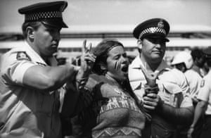 Police arrest a woman during a demonstration for Aboriginal land rights at the 1982 Commonwealth Games in Brisbane
