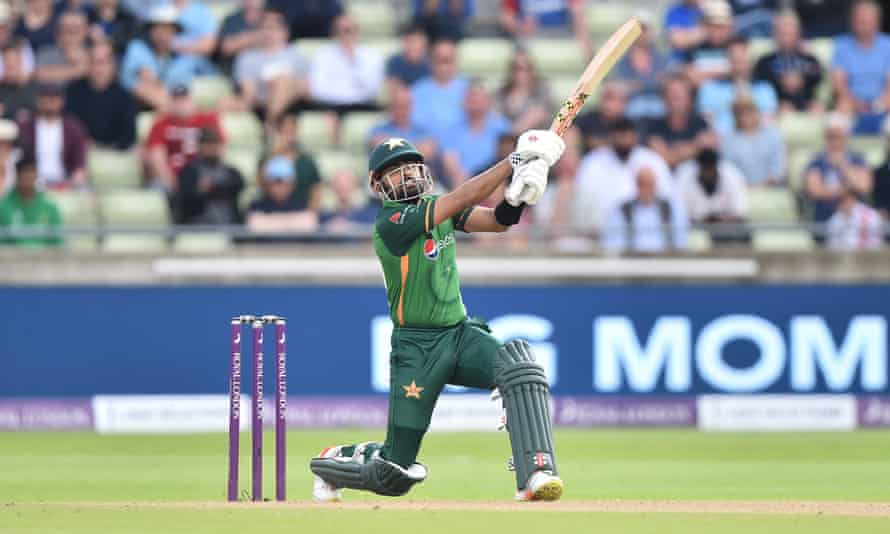 Babar Azam launches one of his four sixes into the crowd.