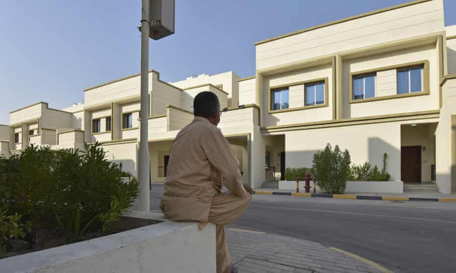 An Afghan man who was evacuated from Kabul sits on a wall at a temporary housing complex in Doha, Qatar.