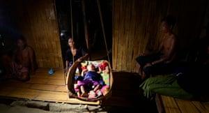 Tripura, India: A newborn Bru baby in a refugee camp