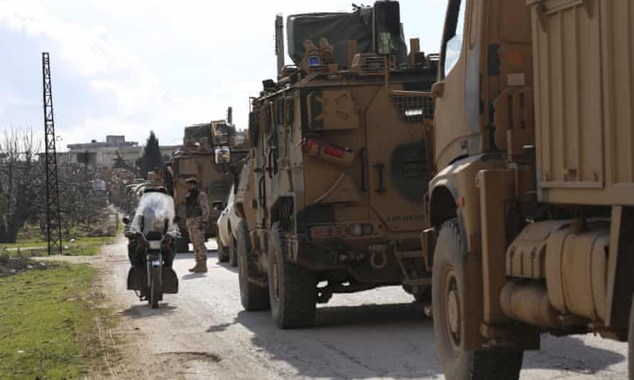 Turkish military convoy stops in Idlib province, Syria.