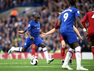 N'Golo Kanté drives past Liverpool's defence to score for Chelsea late in the second half.