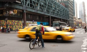 Cyclist narrowly evades car at junction  in New York