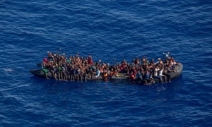 A photo taken from the Moonbird plane  shows hundreds of migrants inside a rubber dinghy