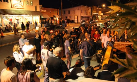 Street musicians perform in a designated bay along Floyd's main street, outside the Country Store, Floyd, Virginia