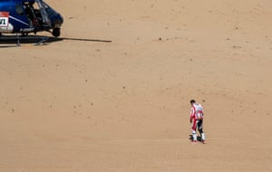 Race driver trudges across desert