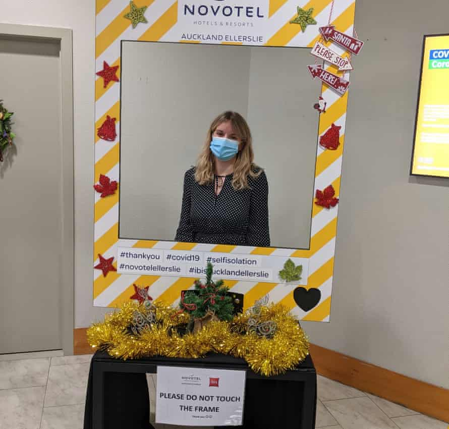 Elle Hunt enjoys the coronavirus quarantine picture booth on Christmas Day at a Novotel in Auckland, New Zealand.