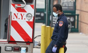 US-HEALTH-VIRUS-PANDEMIC-EPIDEMIC-DISEASE<br>An FDNY paramedic takes a break after bringing a patient to Wyckoff Hospital in the Bushwick section of Brooklyn April 5, 2020 in New York. - The coronavirus death toll in New York state spiked to 4,159, the governor said, up from 3,565 a day prior. The toll increase of 594 showed a slight decrease in the day-to-day number of lives lost compared to the previous day.  Governor Andrew Cuomo told journalists it was too soon to tell whether the decrease from the previous record of 630 deaths in one day was statisically significant. (Photo by Bryan R. Smith / AFP) (Photo by BRYAN R. SMITH/AFP via Getty Images)