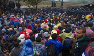 Migrants crowd as they wait to cross the Croatian border.