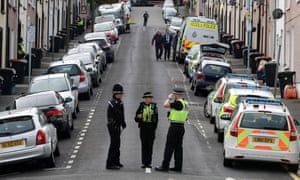 Police during a house search on Wednesday in West Street, Newport, Wales.