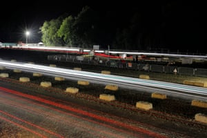 Light trails around the track as the mowers lap incessantly.