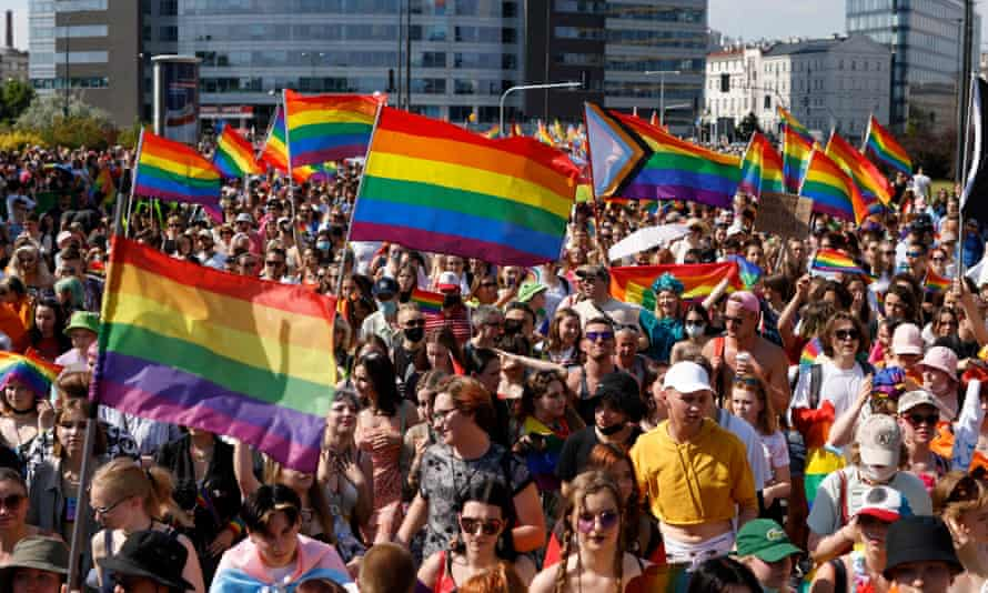 Marchers carry rainbow flags