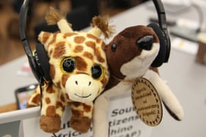 A giraffe and an otter are displayed on a desk at the Convention on International Trade in Endangered Species (Cites) in Geneva. Countries voted to improve protections for all species of giraffe at the Cites conference