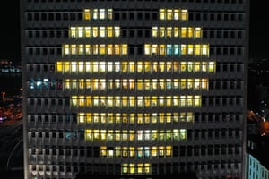 Windows are lit at the Primorye Territory government building to form the shape of a heart in Vladivostok, Russia