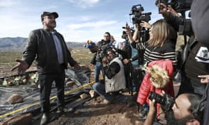 Adrian LeBarón speaks to reporters in the place where one of the cars belonging to the extended LeBaron family was ambushed by gunmen last year near Sonora state, Mexico,