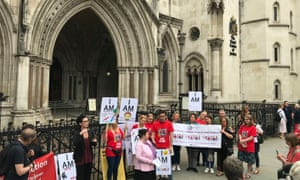 Campaigners outside the Royal Courts of Justice, in London.