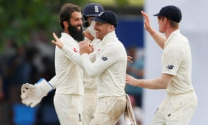 England's Moeen Ali celebrates with Jack Leach and Keaton Jennings after taking the wicket of Niroshan Dickwella.