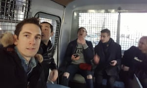 Alec Luhn with other detainees inside the police van.