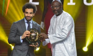 Mohamed Salah receives the African Footballer of the Year award from Liberian president and former Milan forward George Weah in Dakar