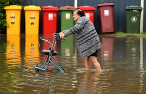 A woman leaves her home in central Lismore