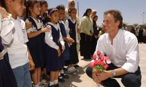 Tony Blair is greeted by children in Basra, Iraq, in May 2003