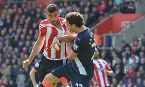 Daryl Janmaat, right, challenges Graziano Pellè in the kind of battle he is more accustomed to.
