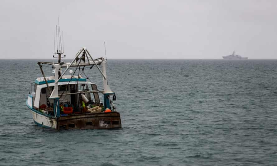 A British navy patrol vessel (right) and a fishing boat in waters off the island of Jersey on Thursday.