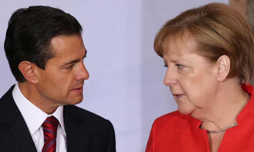 Angela Merkel speaks with Mexico's president, Enrique Peña Nieto, in Mexico City.
