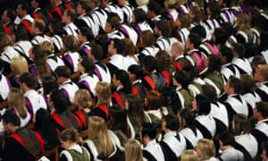'A debt-fuelled race for economic preferment in later life': students at a university graduation ceremony.