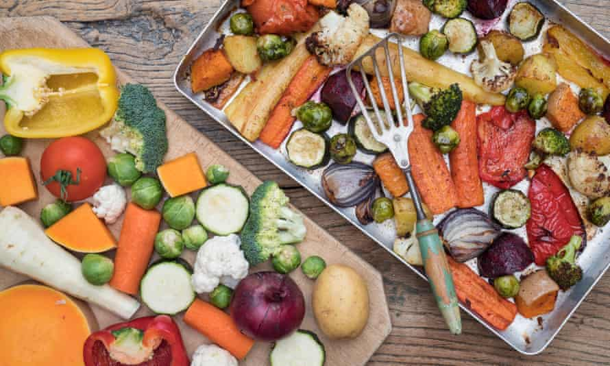 Trays of raw and roasted vegetables