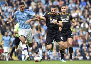 Rodrigo, left, and Patrick Cutrone tussle for the ball during Manchester City's defeat by Wolves.