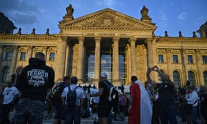 Anti-Covid restriction demonstrators confront the police in front of the Reichstag building in Berlin.