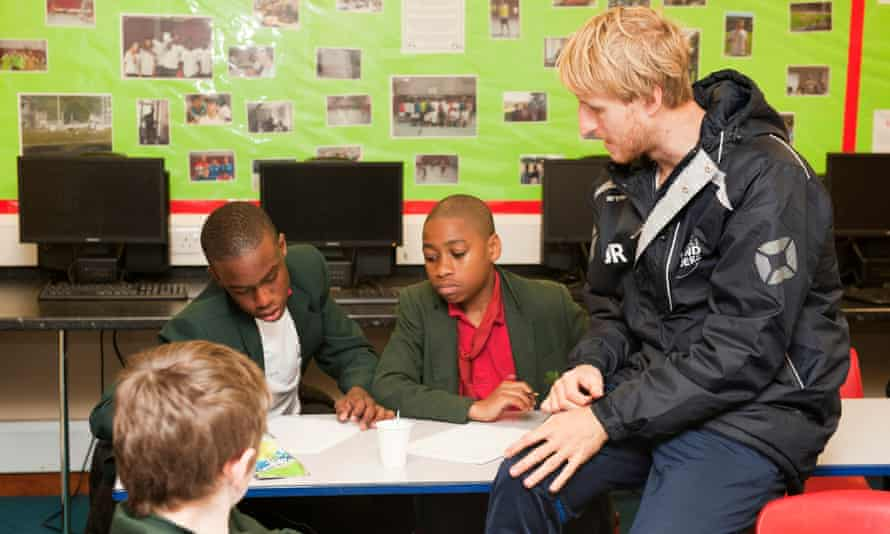 Jack Reynolds of Football Beyond Borders, with some school pupils.