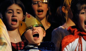 Children singing in a school play.