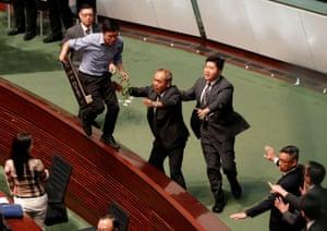 A man walks on furniture at the legislative council in Hong Kong
