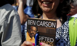 A woman waits to have Republican presidential candidate Ben Carson autograph her book at the Iowa State Fair in Des Moines.
