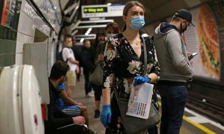 A commuter wearing a face mask.