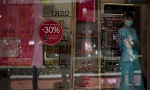 A woman waits for customers at a beauty store in Sofia, Bulgaria.