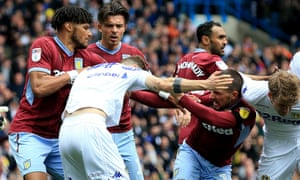 Leeds United's Mateusz Klich is confronted by Aston Villa's Conor Hourihane after he scores his side's first goal while Aston Villa's Jonathan Kodjia was down injured.