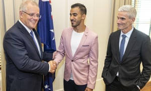 Prime minister Scott Morrison (left), Hakeem al-Araibi (centre) and Craig Foster at the Commonwealth Offices in Melbourne on Tuesday,.