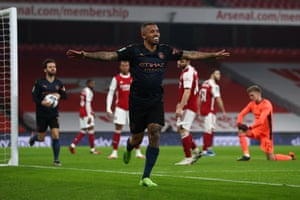 Gabriel Jesus of Manchester City celebrates after scoring their team's first goal.