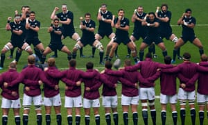 England's players look on as New Zealand's players perform the haka before a Test match in November 2013 at Twickenham.