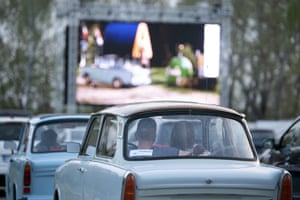 "Visitors sit in a Trabant to watch the film ""Go Trabi Go,"" in Dresden, Germany"