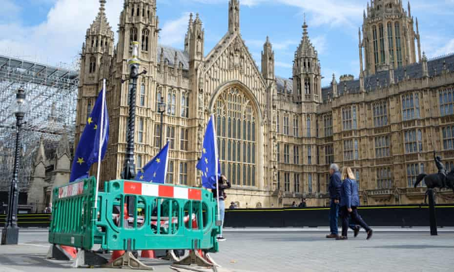 EU flags attached to barriers outside the Houses of Parliament in London on