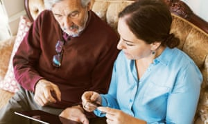 Senior man doing online shopping with daughter through credit card and digital tablet<br>GettyImages-737361351