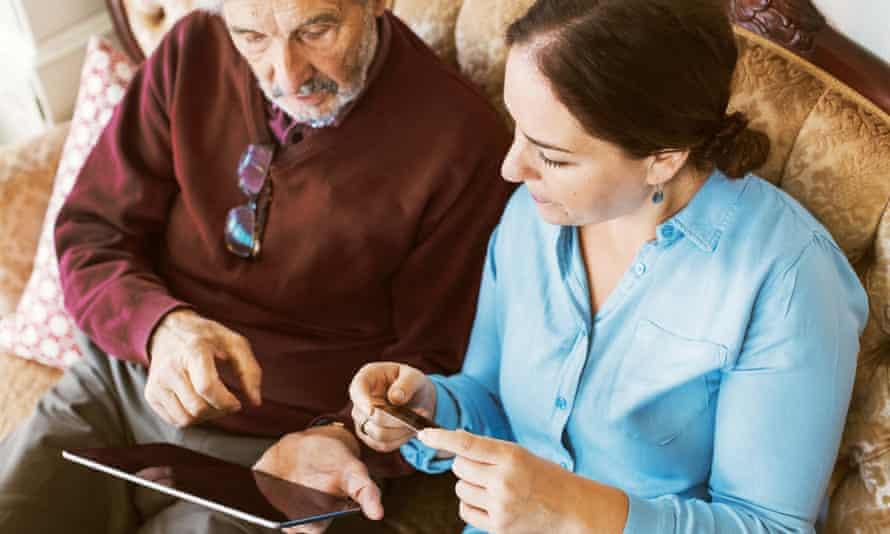 Older man online on tablet with daughter
