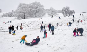 People play in the snow in Aberfan, south Wales.