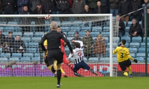 Lee Gregory of Millwall goes close after just 18 seconds when his shot clatters against the bar.