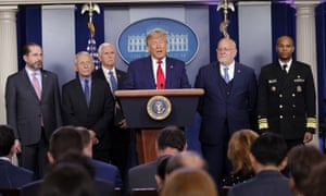Donald Trump speaks about the coronavirus with Alex Azar, health and human services secretary; Dr Anthony Fauci, National Institute for Allergy and Infectious Diseases director; Mike Pence, vice-president; Robert Redfield, director of the CDC; and Dr Jerome Adams, the US surgeon general.